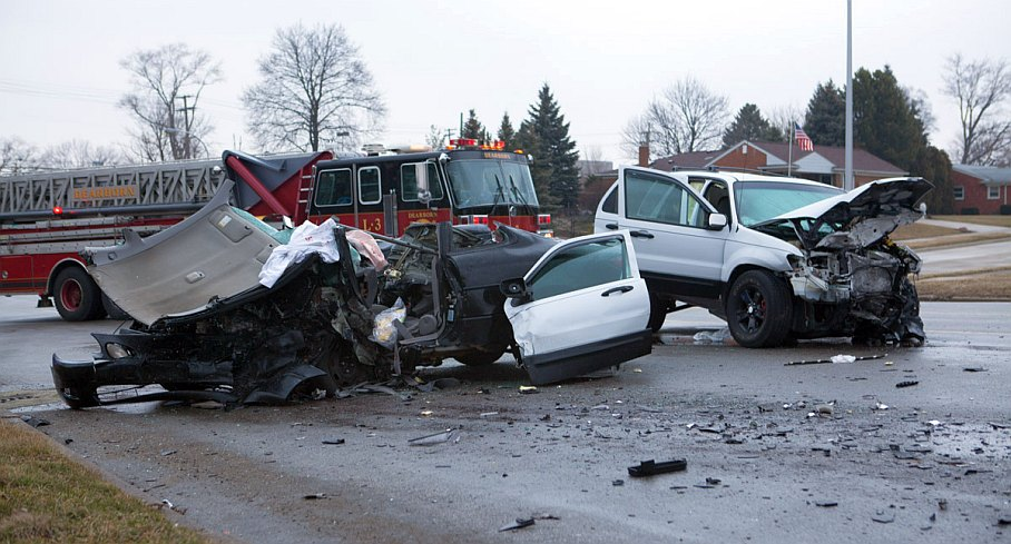 Wreckage and debris -scattered everywhere after terrible car accident on Friday, March 15 - on Outer Drive, near Park Street in Dearborn. (Photo by Jordan Ewert)