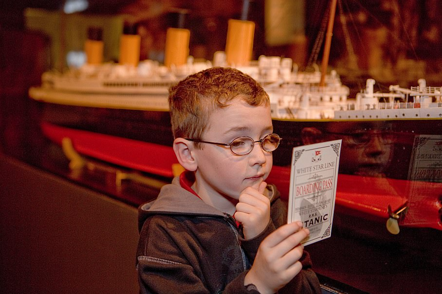 Young boy examines boarding pass for the Titanic - at the Henry Ford Museum in Dearborn, Michigan