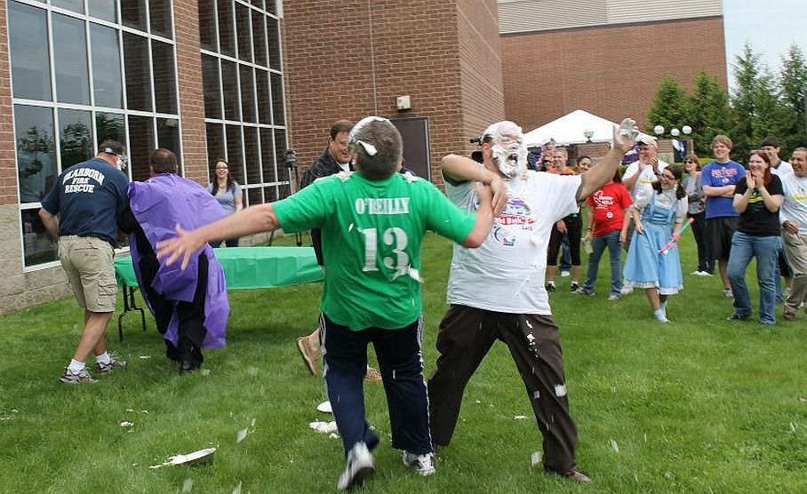 Despite wearing a Team O'Reilly T-shirt in an apparent attempt to get a measure of pie-slinging mercy from the Mayor , Wayne County Commissioner Gary Woronchak was hit with a pie by Mayor John B. O'Reilly, who himself had already been creamed in the fund-raising event at Relay for Life.