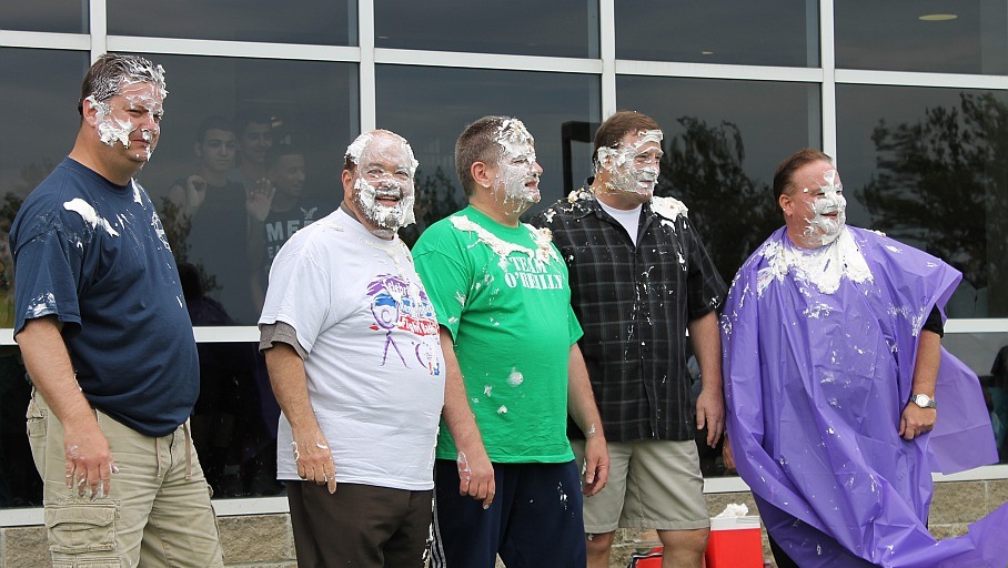 After the pies had been thrown, the messy participants at Four Pies and a Poncho displayed the results. From left are Dearborn Firefighters Burn Drive Chairman and Fire Lt. Steve Worden, Mayor John B. O'Reilly, Wayne County Commissioner Gary Woronchak, Dearborn High Principal Chuck Baughman, and Superintendent Brian Whiston.