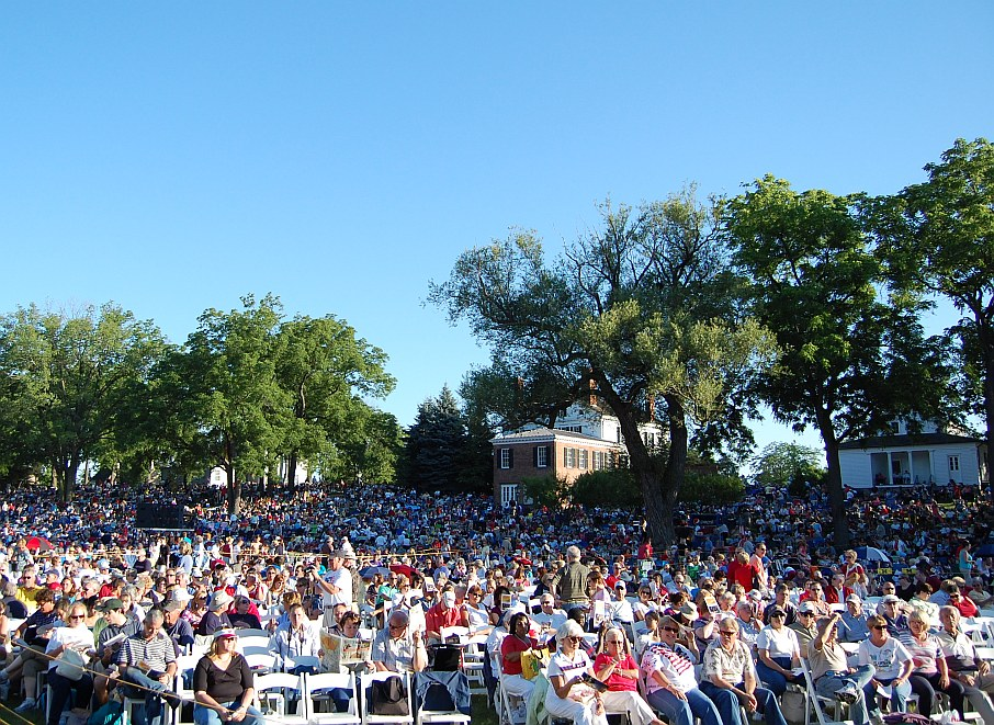 A large audience spreads out in the walnut grove plains at Greenfield Village in Dearborn, Michgian