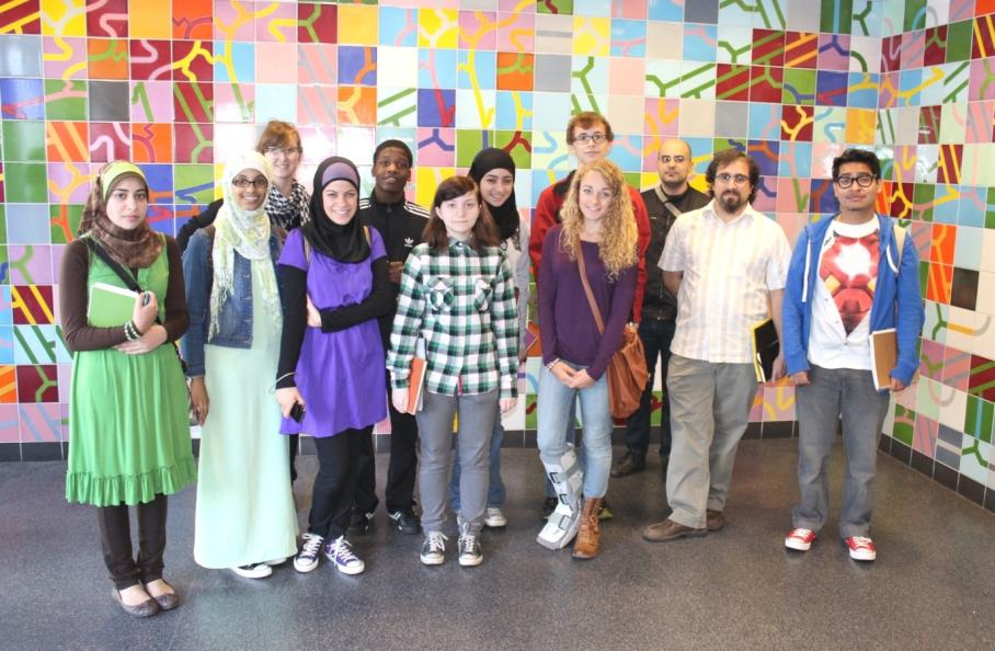 Ten students from Edsel Ford, Fordson and Dearborn High School in Dearborn have been selected by the Dearborn Community Fund to work on the 2012-13 Pockets of Perception project team. The students will design a mosaic to be installed in Dearborn's new Intermodal Passenger Rail Station, scheduled to open in late 2013. For inspiration, the team visited mosaics and murals at Detroit's People Mover Stations, the Detroit Public Library and the College for Creative Studies. Visiting the mosaic at the Renaissance Center People Mover Station, from left, front: Reem Aoun, Siham Saleh, Mary Charara, Aleen Bazzi, Khalid McDowell, Claire Young, Mona Beydoun, Leah Wendzinski, Jack Davis (in back), Paolo Mastrogiacomo (chaperone), POP instructor Mohamad Bazzi, and Frankie Nunez.